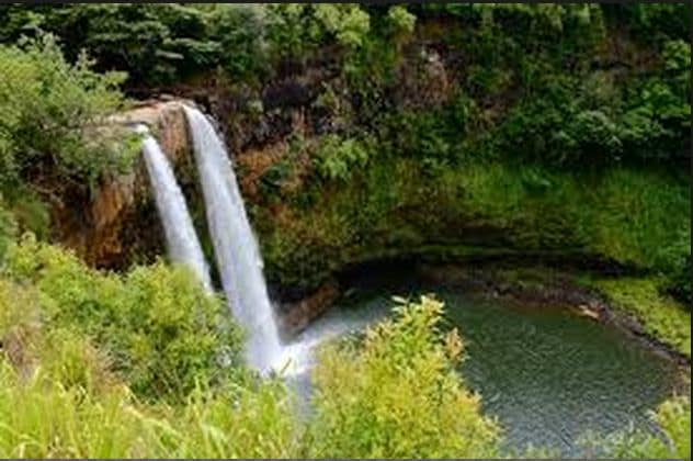 You will pass Opaekaa Falls on your way up to our home.