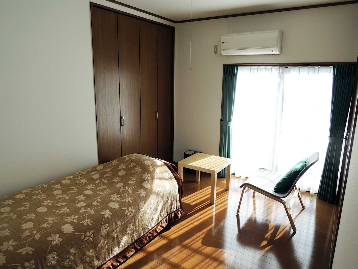 Bed, Chair, Table & Air Conditioner room. Floor space: 10m^2.