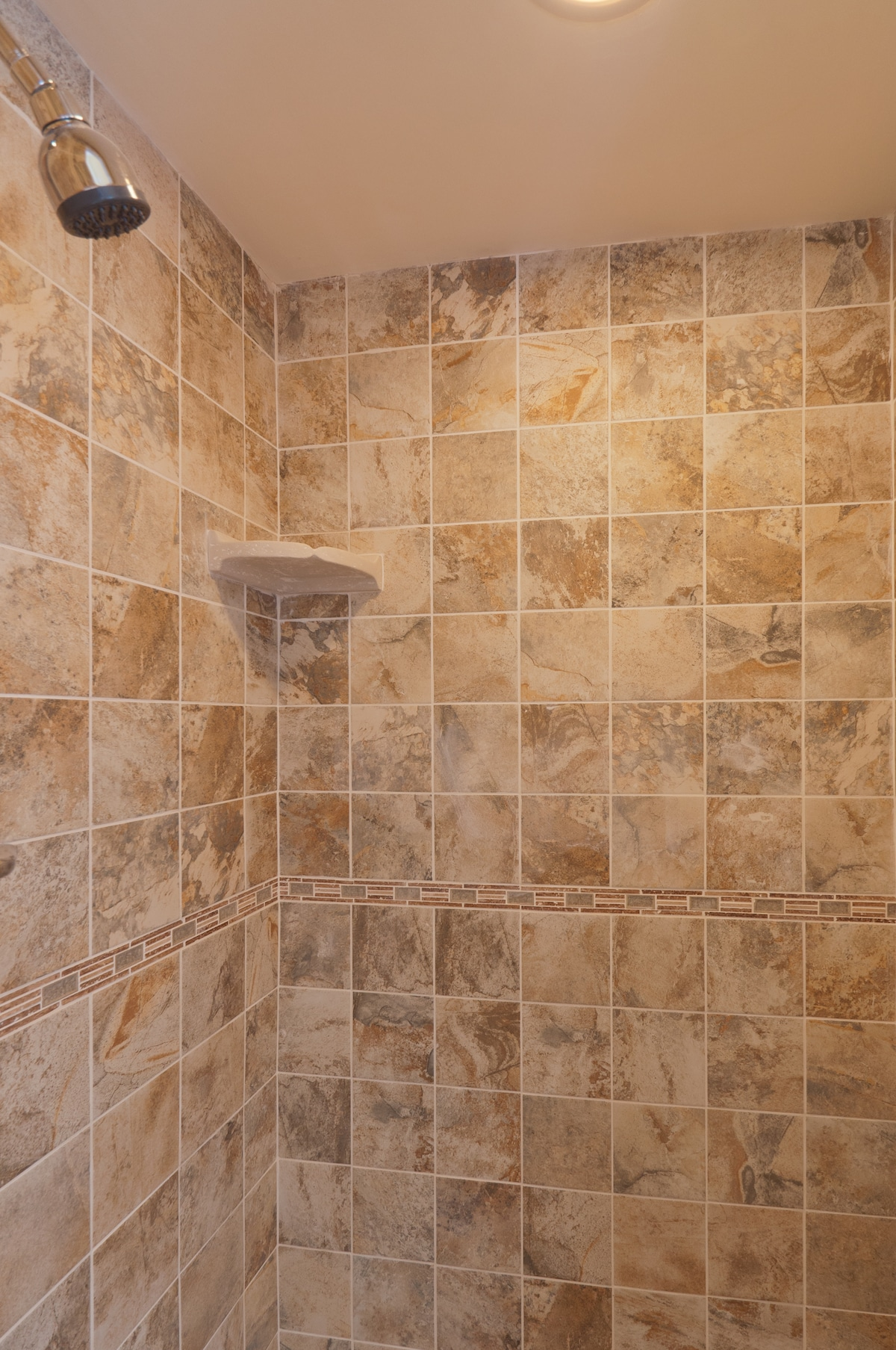 Brand new shower with natural stone tile