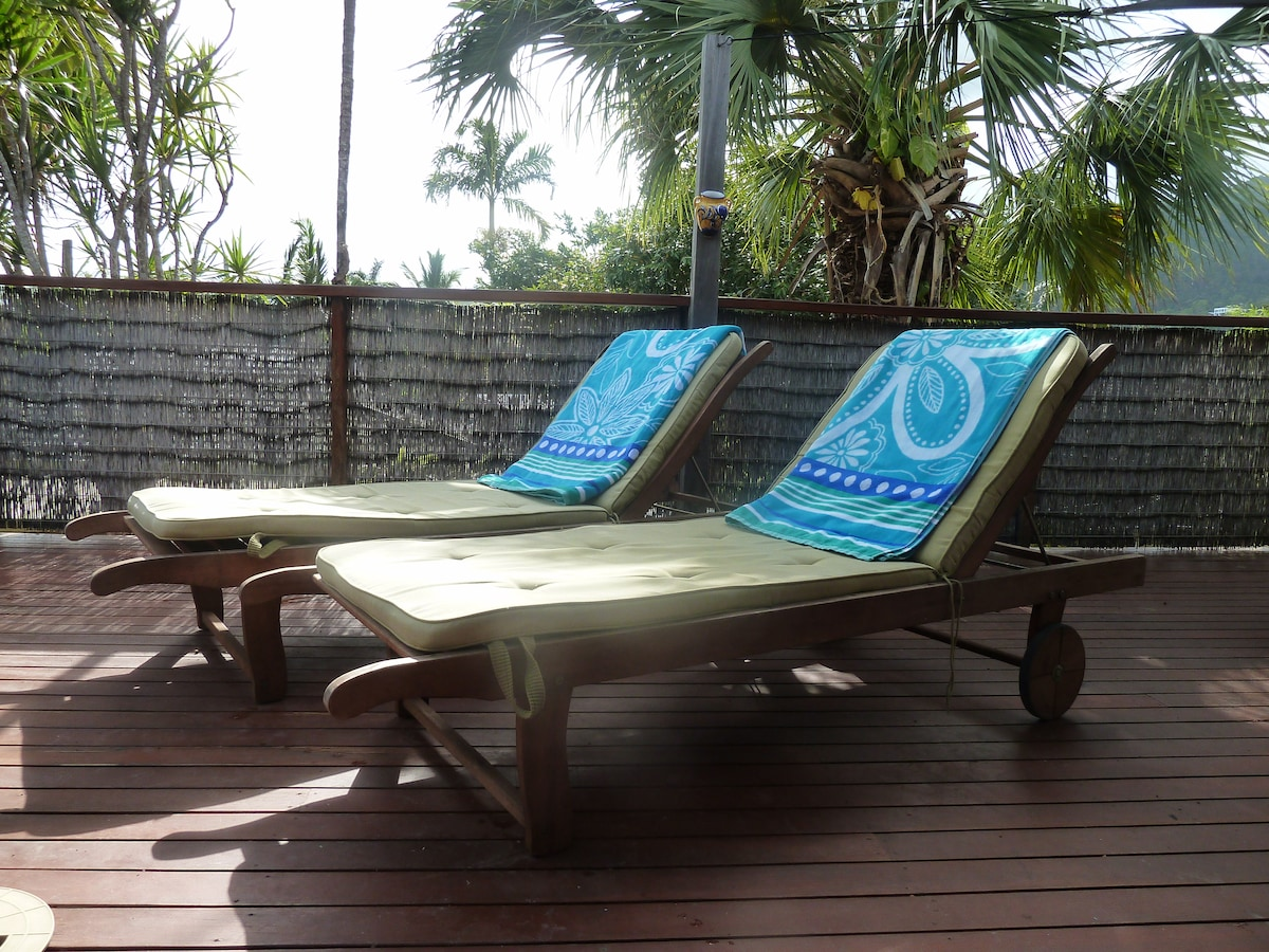 Lounge in the sun or shade by the pool