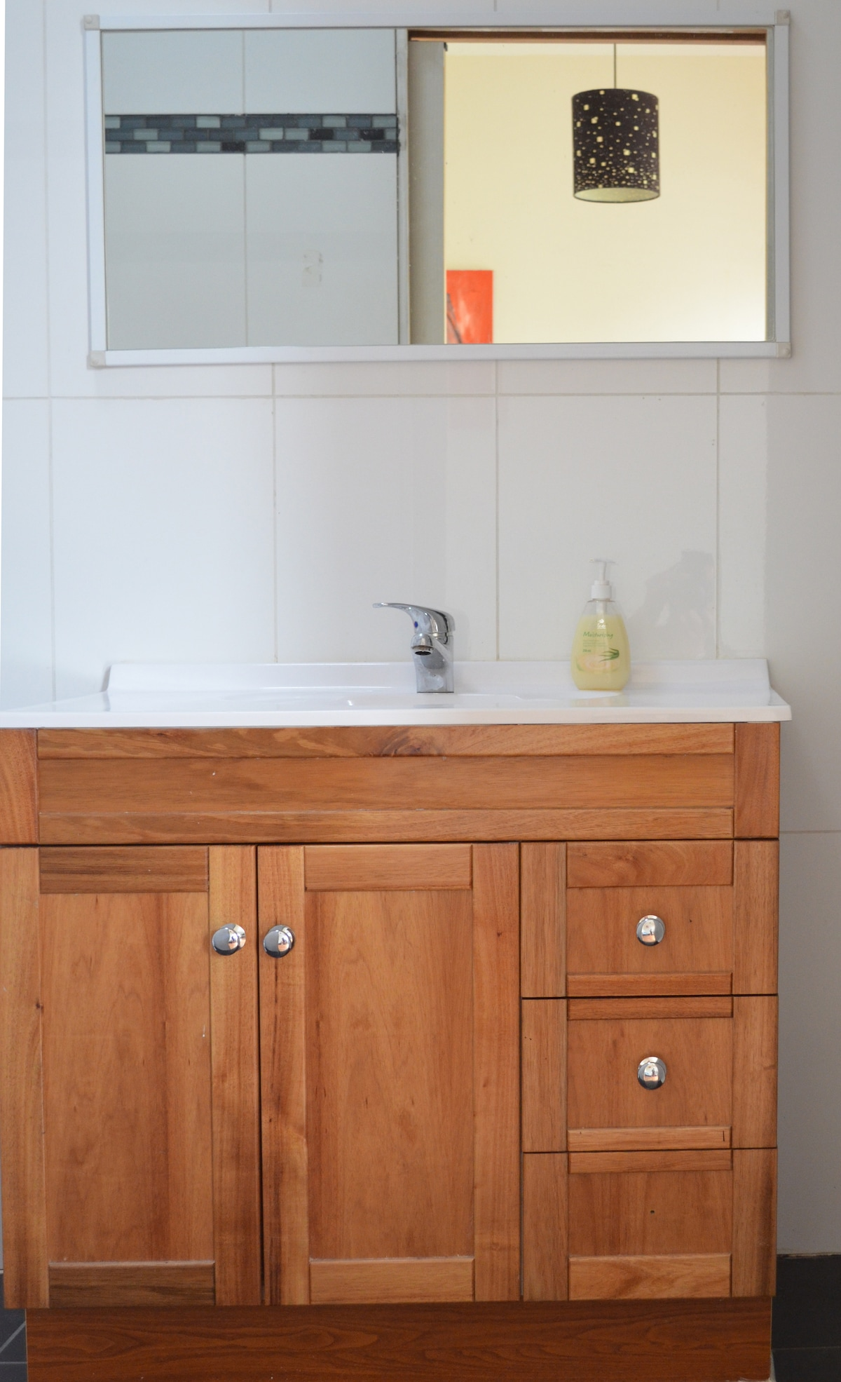 Your own private bathroom has a large vanity and plenty of space.