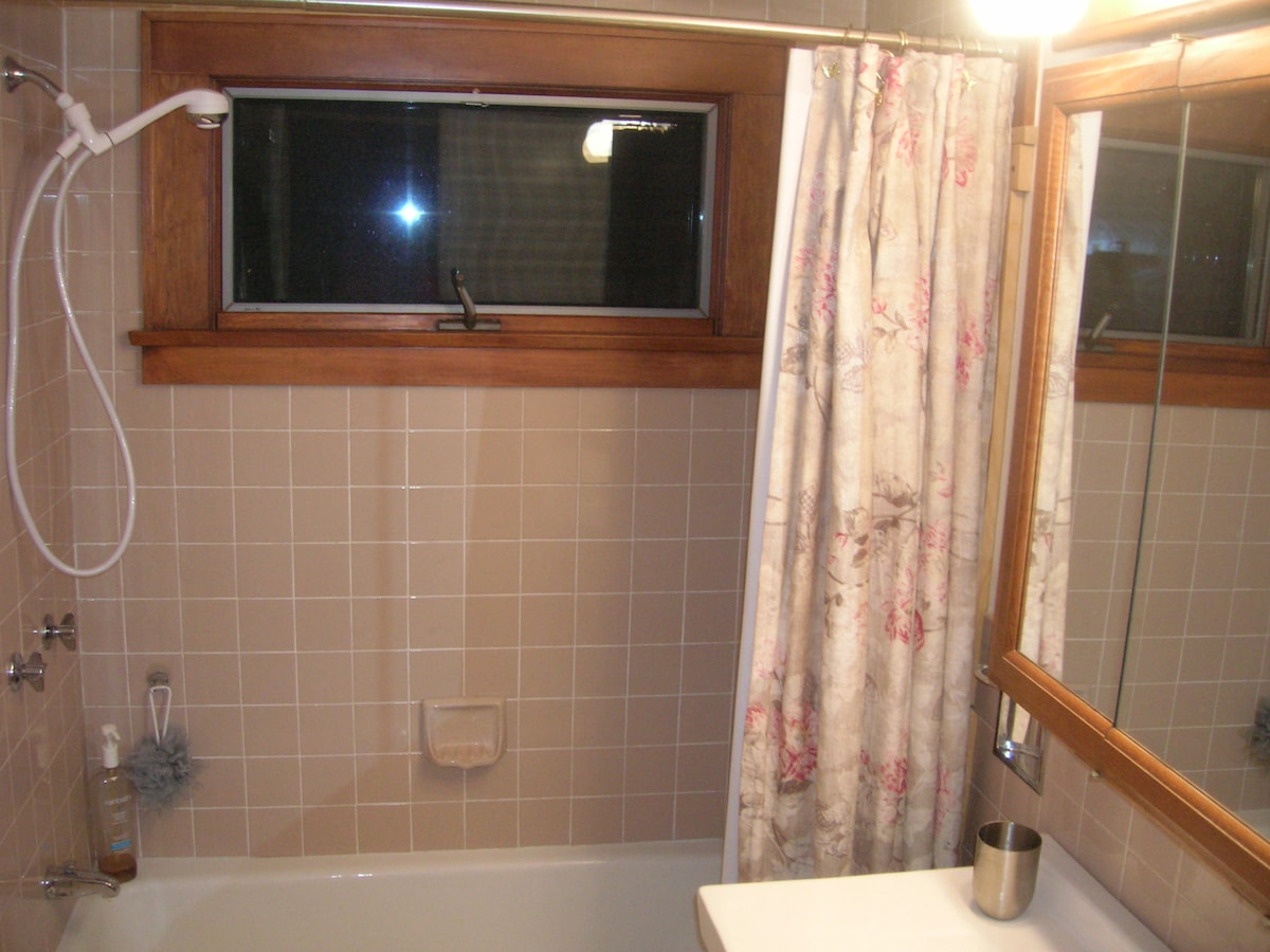 One bathroom has a tub/shower combo