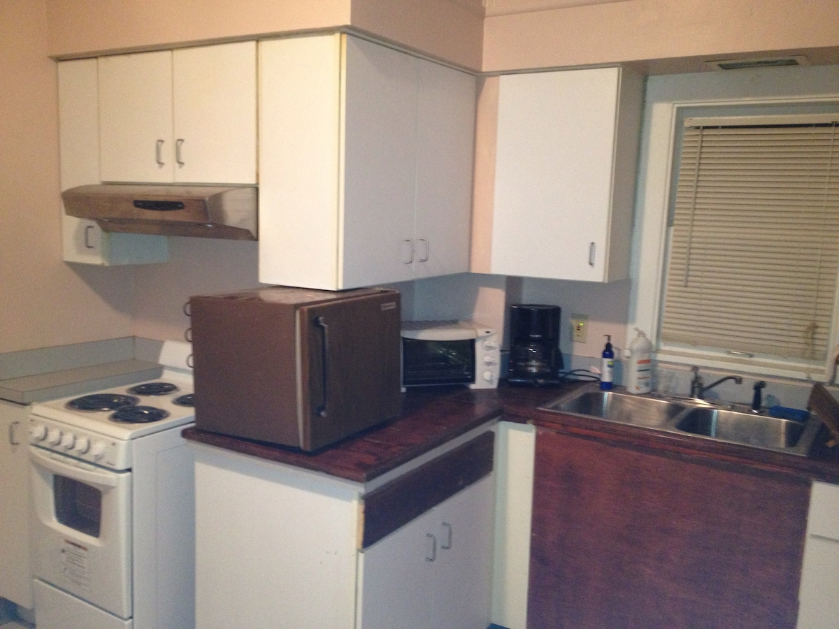 Small stove, oven, college sized refrigerator, toaster and coffee maker for your convenience.