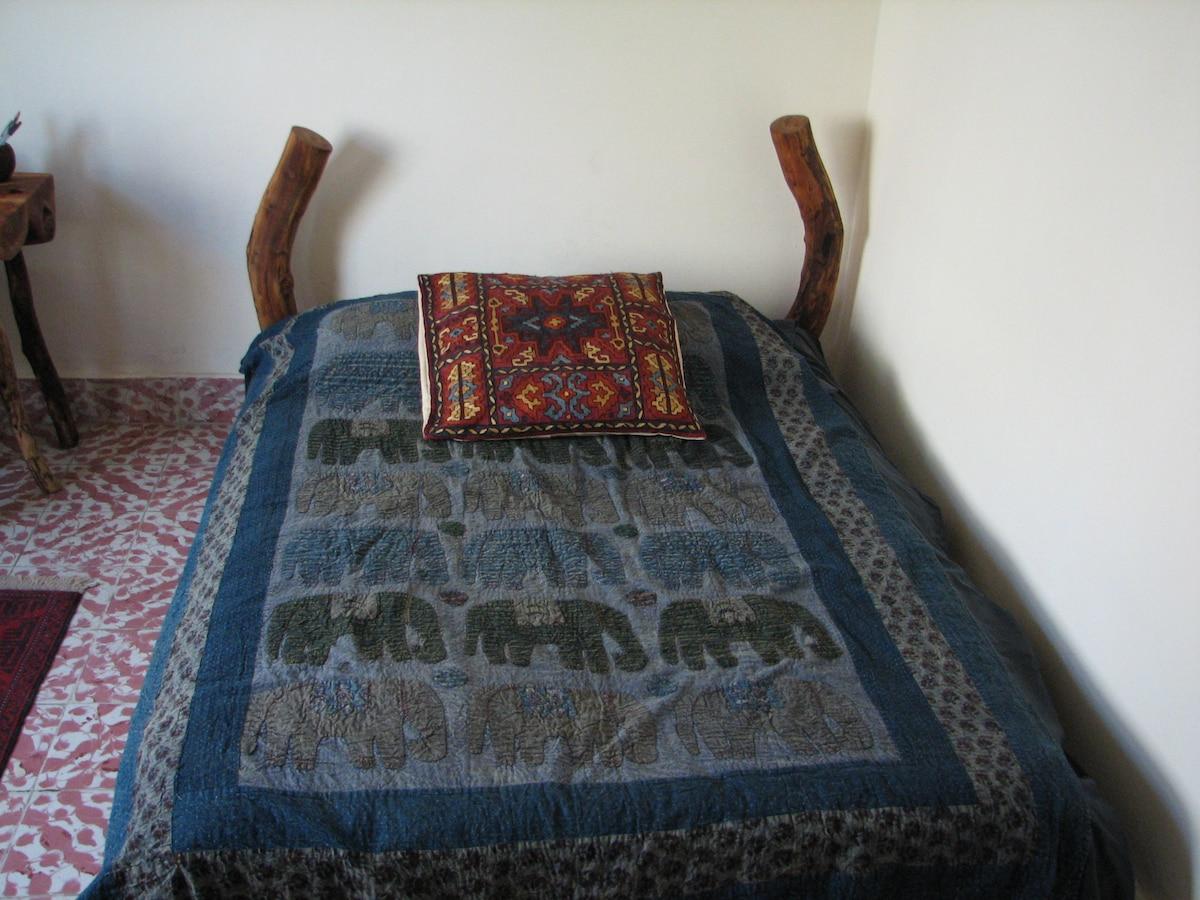 Handmade bed frame and organic mattress.