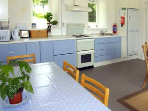 Double oven, fridge freezer, microwave. Washer and dryer in outside laundry room