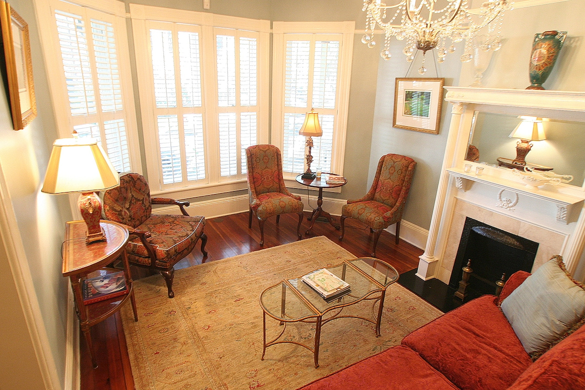 Spacious and bright livingroom looks out onto beautiful Chatham Square