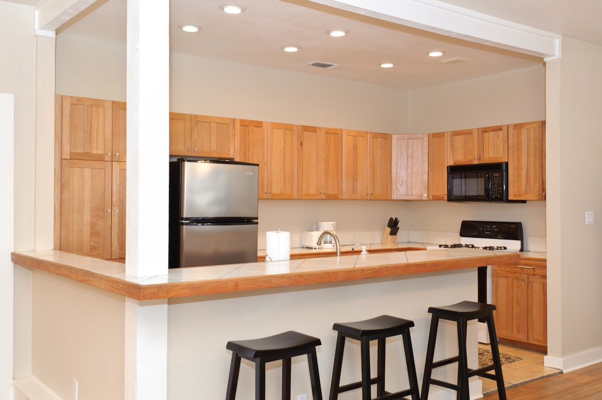 Spacious kitchen with breakfast bar and tons of counters pace for all your cooking needs.