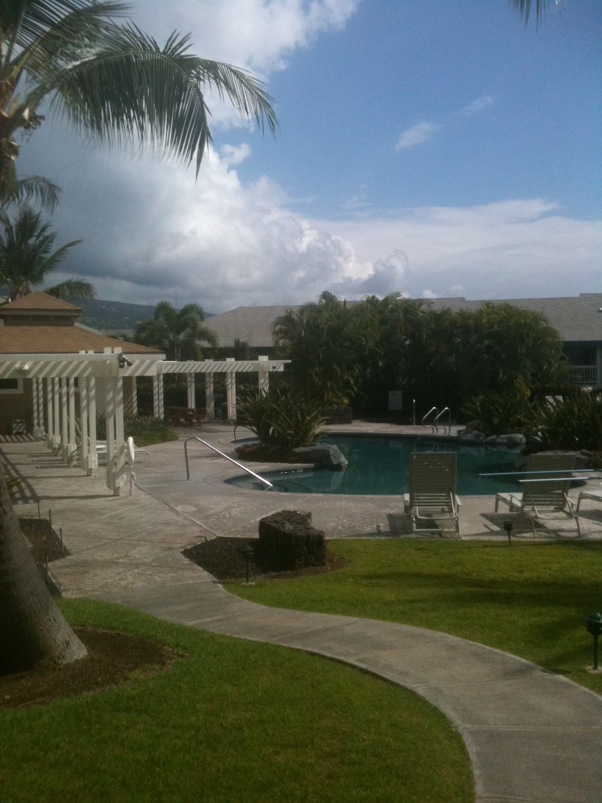view from back lanai, pool , spa, and Bar-b-Q