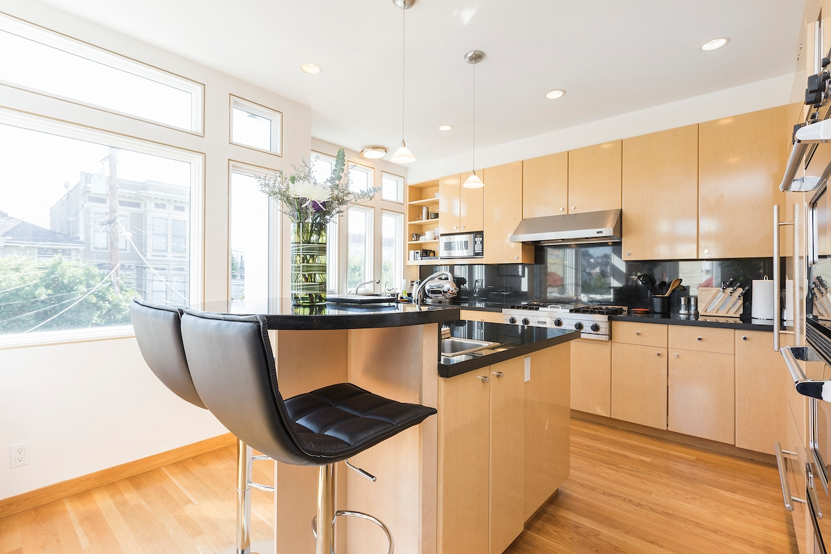 Sunny gourmet kitchen with breakfast nook