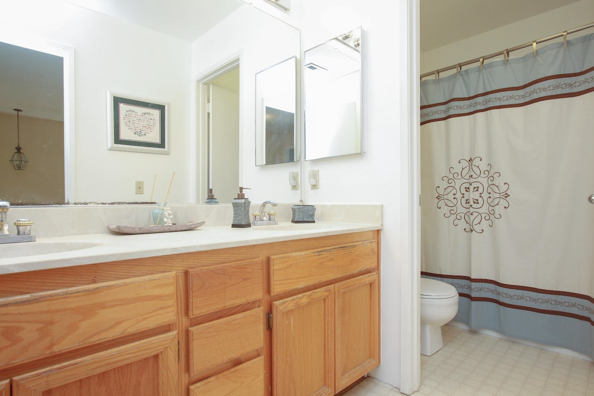 Your bathroom with 2 sinks and separate toilet and bath/shower