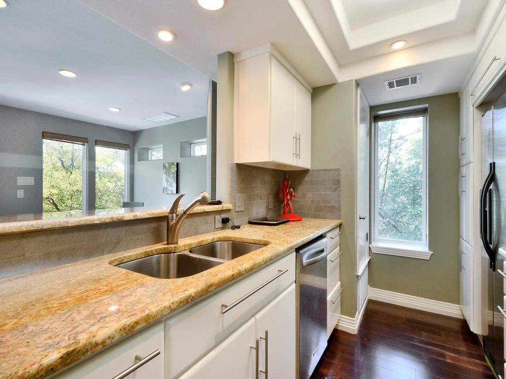 The kitchen has top of the line counters and appliances.