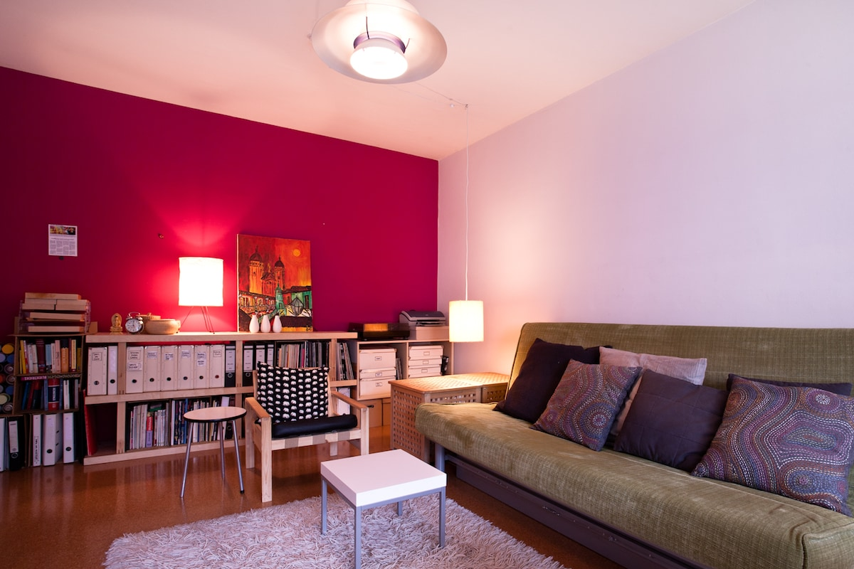 I don't mind grey weather or rainy days. My magenta wall and my PH5 Lamp (Design: Poul Henningsen) keeps me happy all the time. The bed turns into a sofa at daytime
