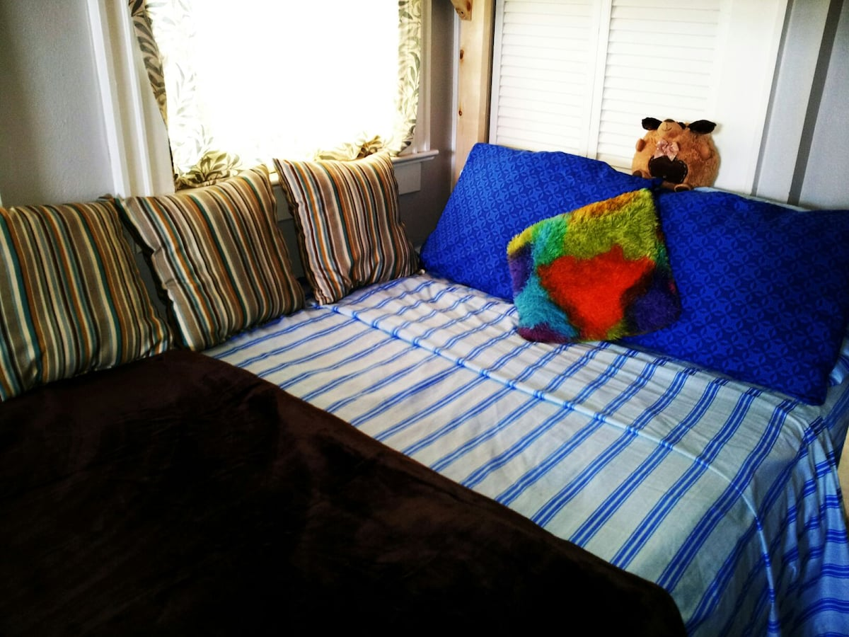 cozy double bed with memory foam mattress topper.