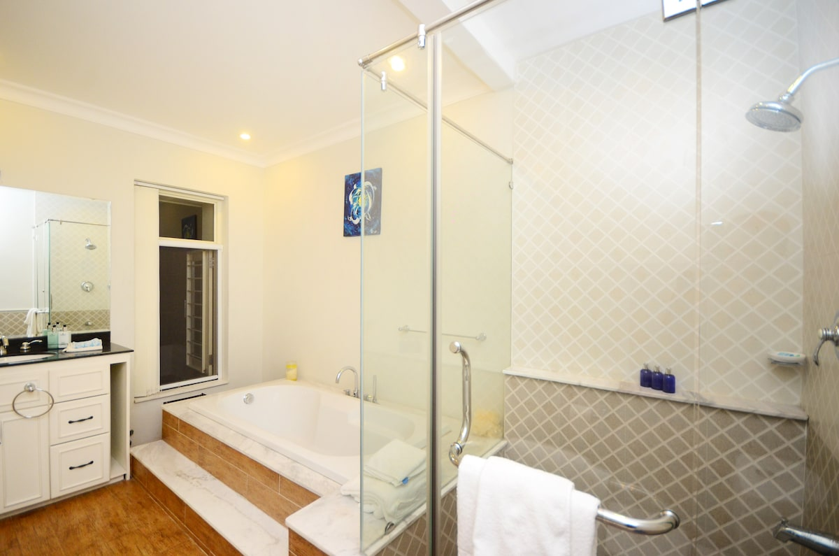 Your bathroom with bathtub and shower