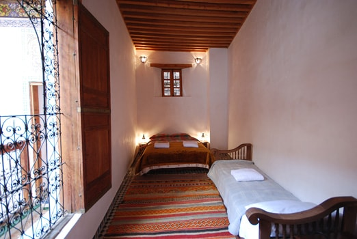 Grand bedroom has one double bed and one single.