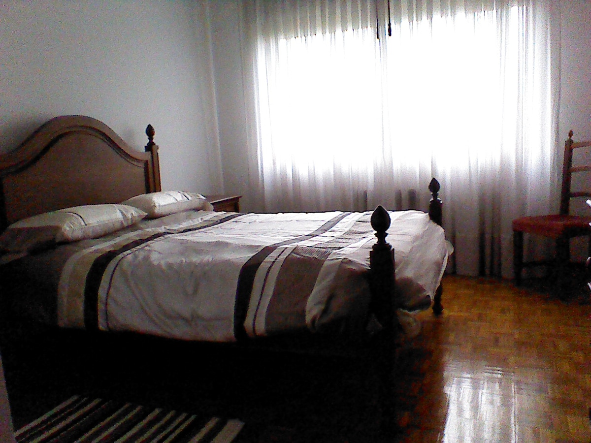One of the rooms with double bed and plenty natural light