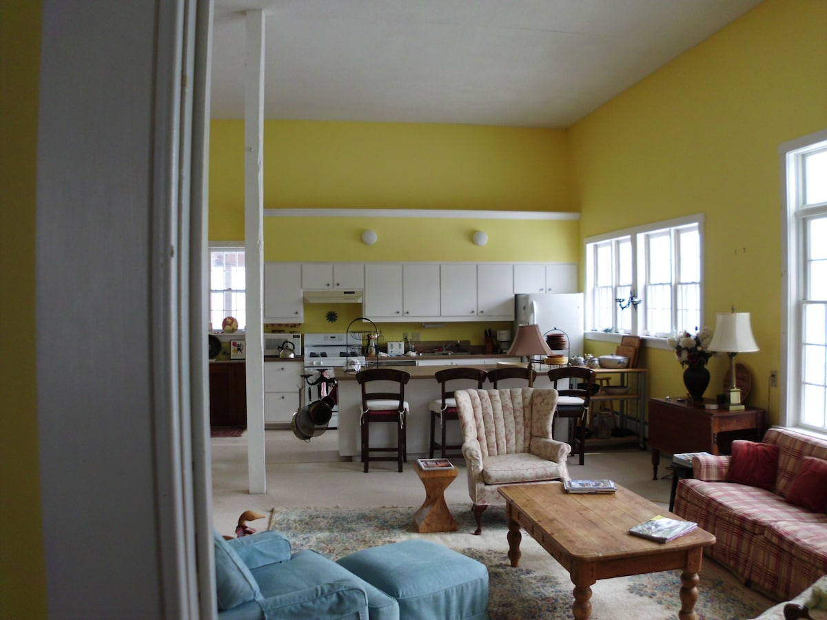 View of the living room area and kitchen from the doorway of the west king sized bedroom