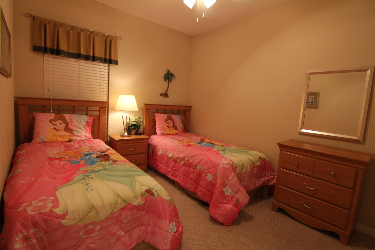Upstair girls room with two twin beds