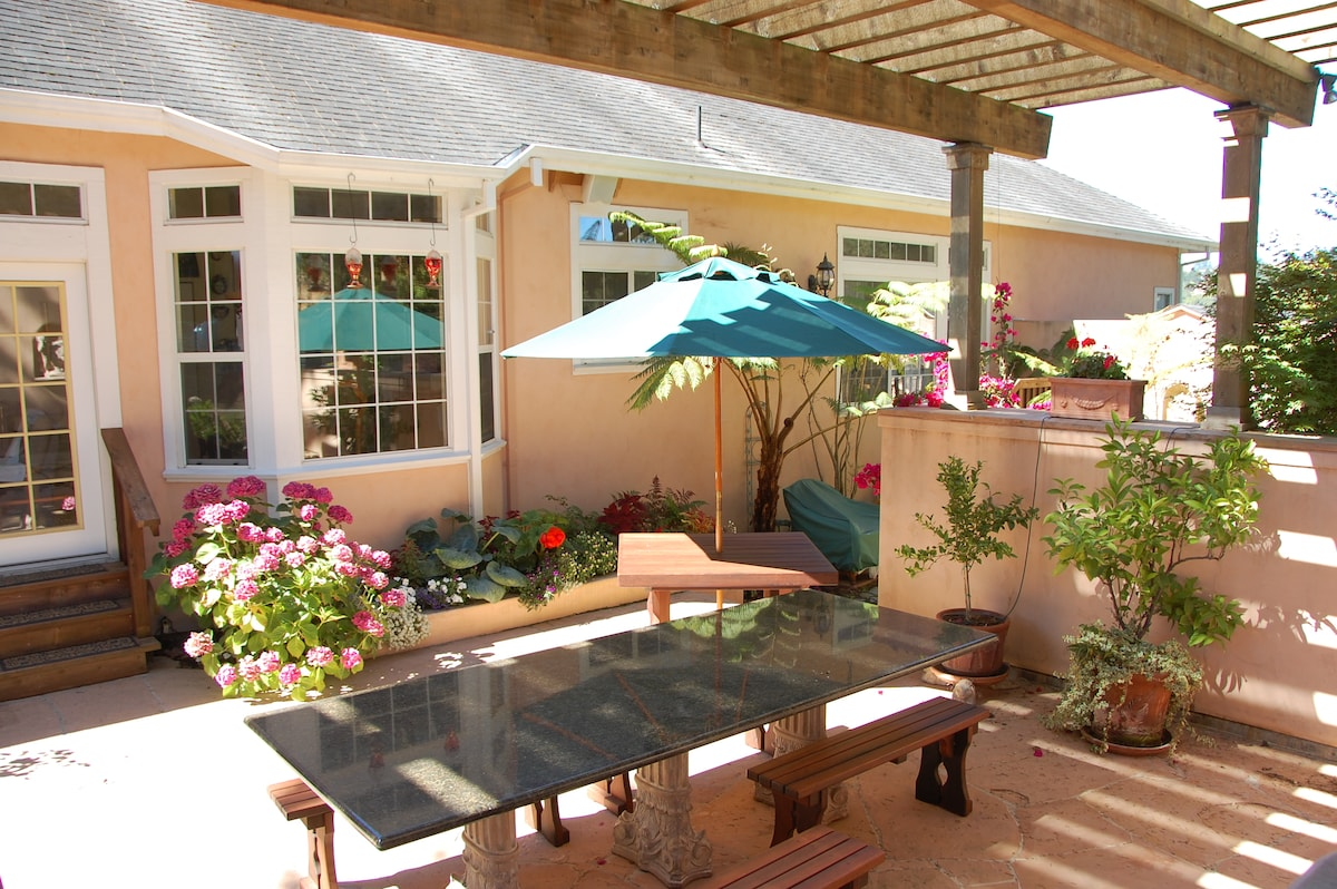 The courtyard has dining for 12 at the granite table with fireplace