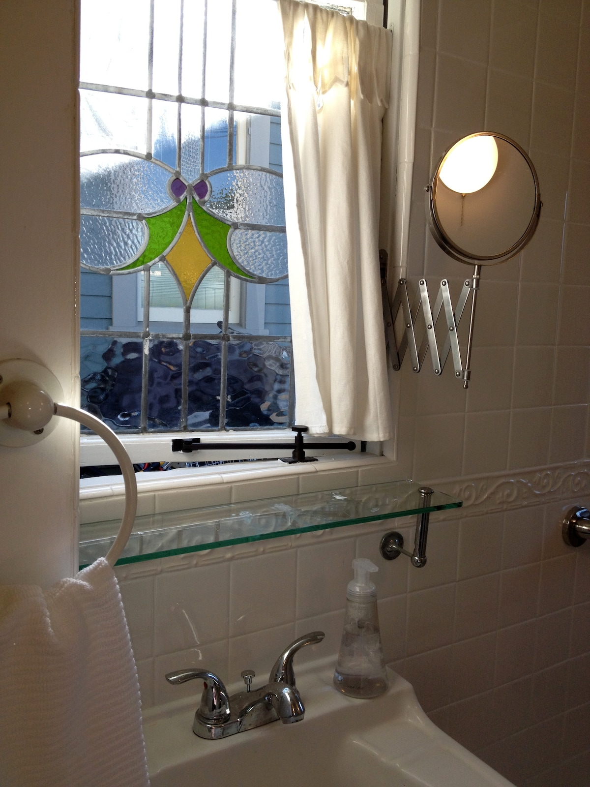 Stainglass above bathroom sink