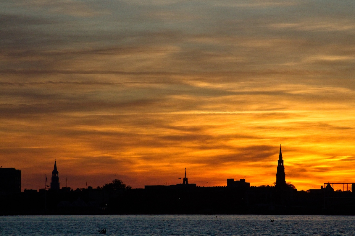 Sunset over historic downtown Charleston as viewed from the decks of Horizon Seeker