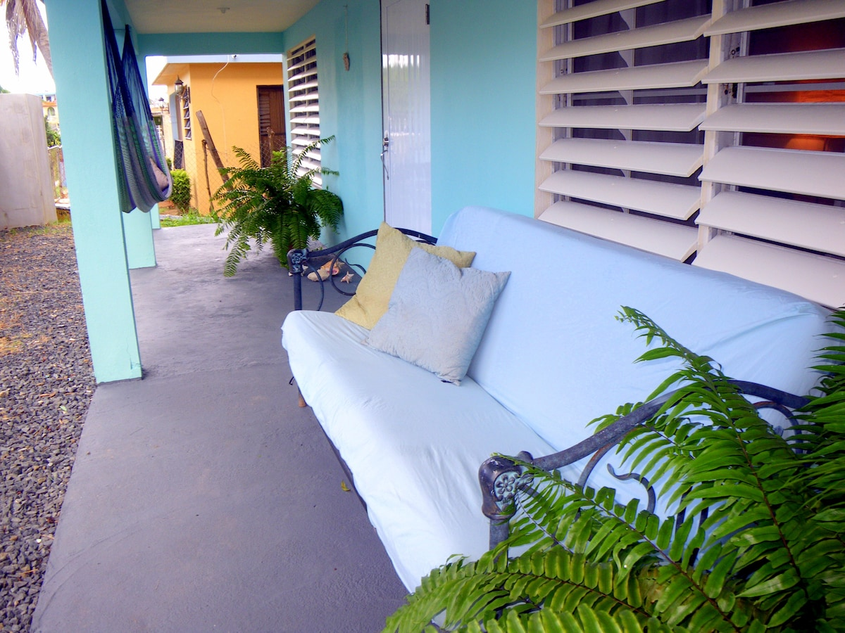 Outdoor sofa seating on the front porch