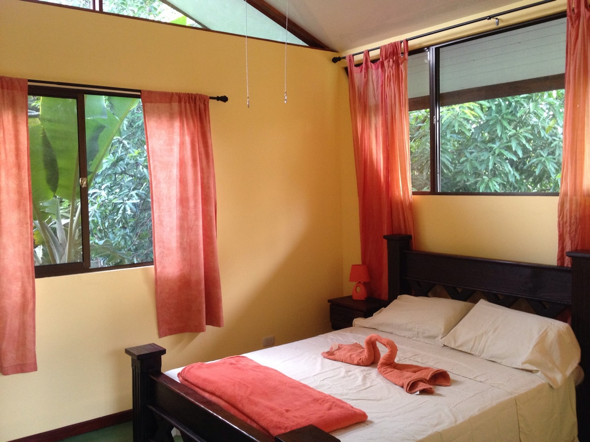 Master bedroom shaded by banana and mango trees