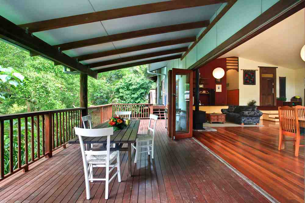 Space and tranquility with the forest. The bedroom is further down, with doors opening onto this verandah and peaceful view