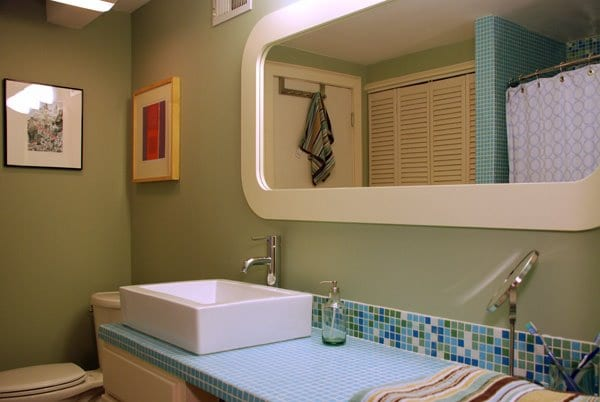 Renovated full bath with attached laundry room.