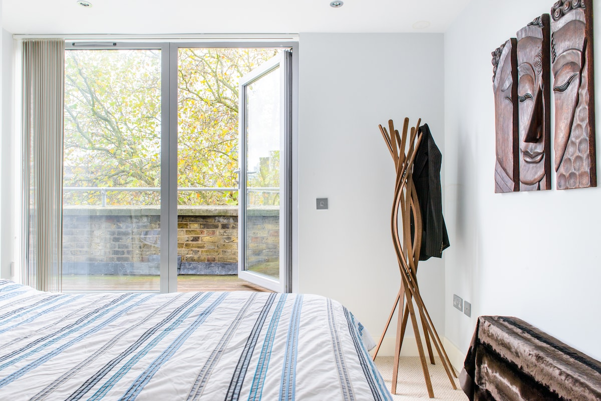 Spacious, light-filled en suite bedroom with excellent quality bed.