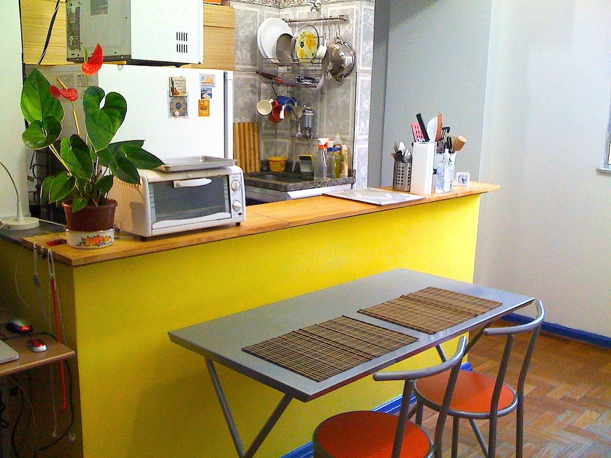 Dining table set for two with the kitchen at the background -