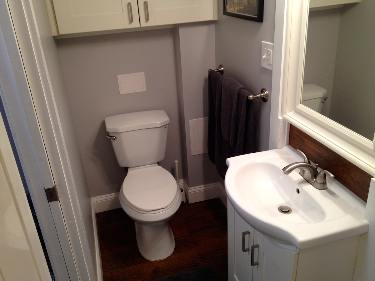 The bathroom includes a shower, hair dryer and large storage cabinet.