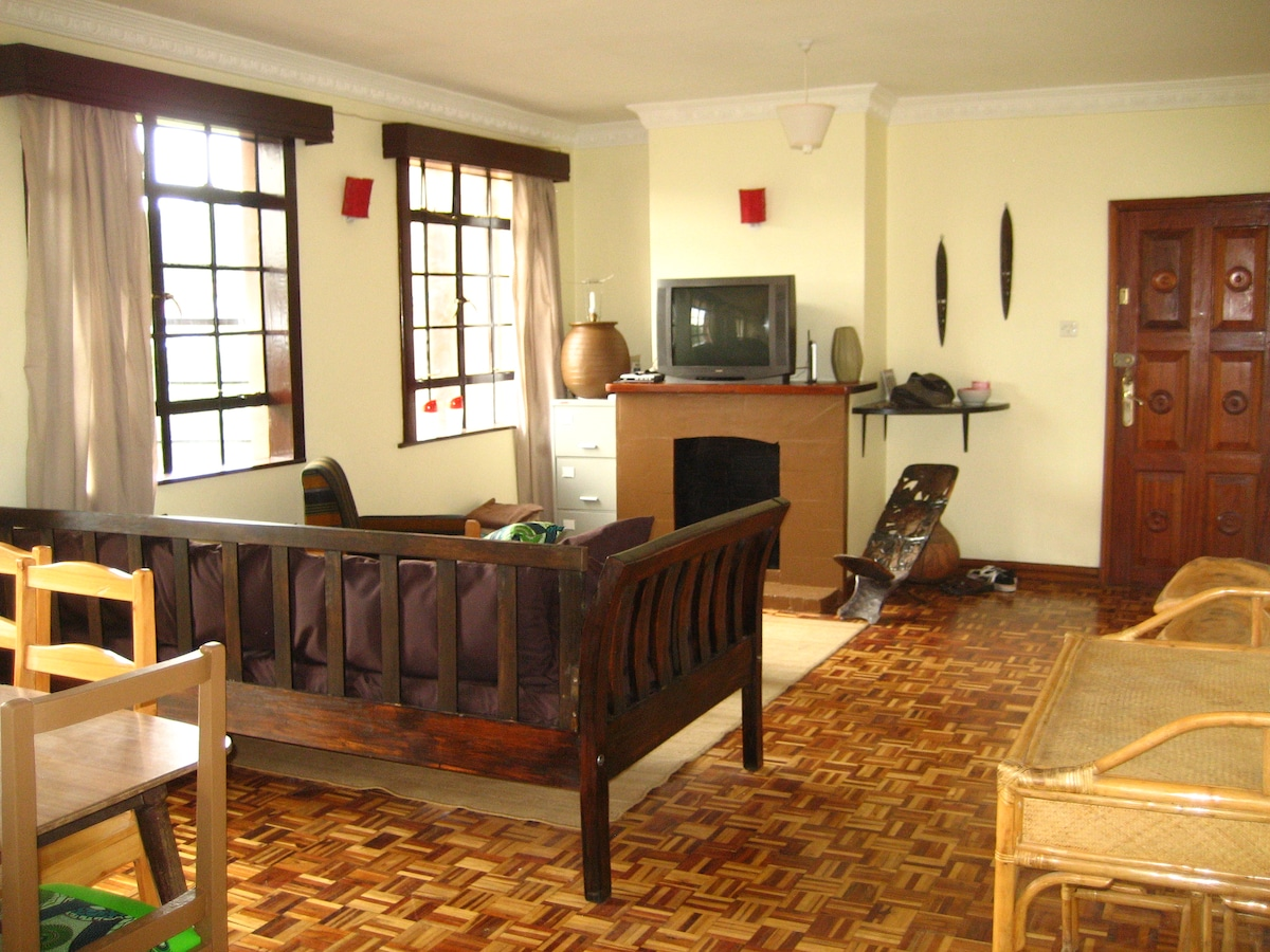 Large, bright sitting room with satellite tv and wireless internet.