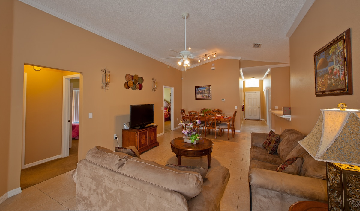 Living room with LCD HDTV, DVD player, game console and wireless internet access