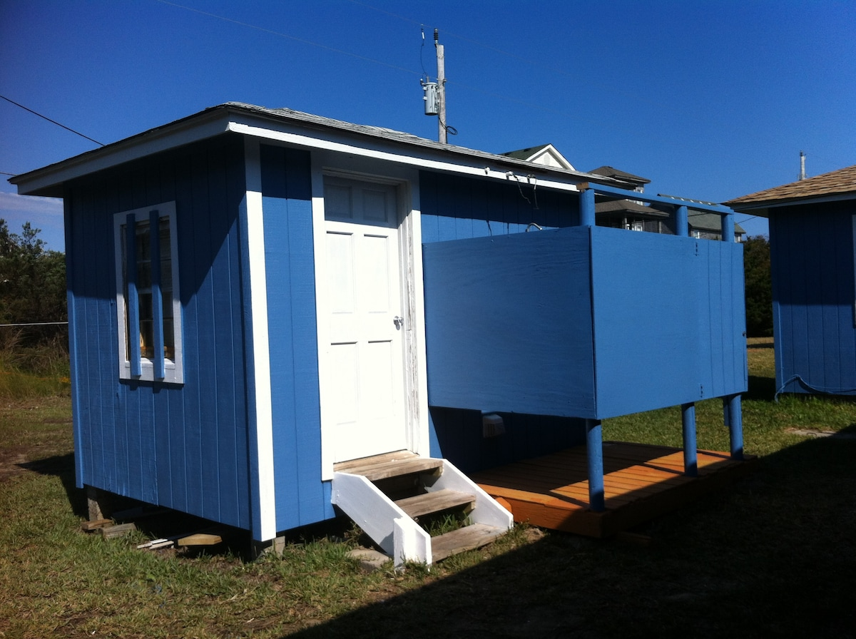 back shed with our spacious outside shower and washer/dryer room