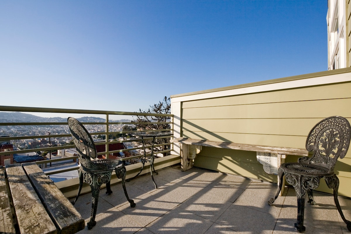 Enjoy your morning coffee or an evening glass of vino on the west deck, overlooking the City