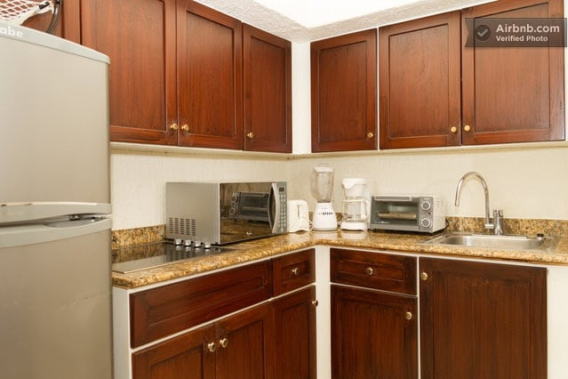 kitchen has four burner stove top and everything else you need