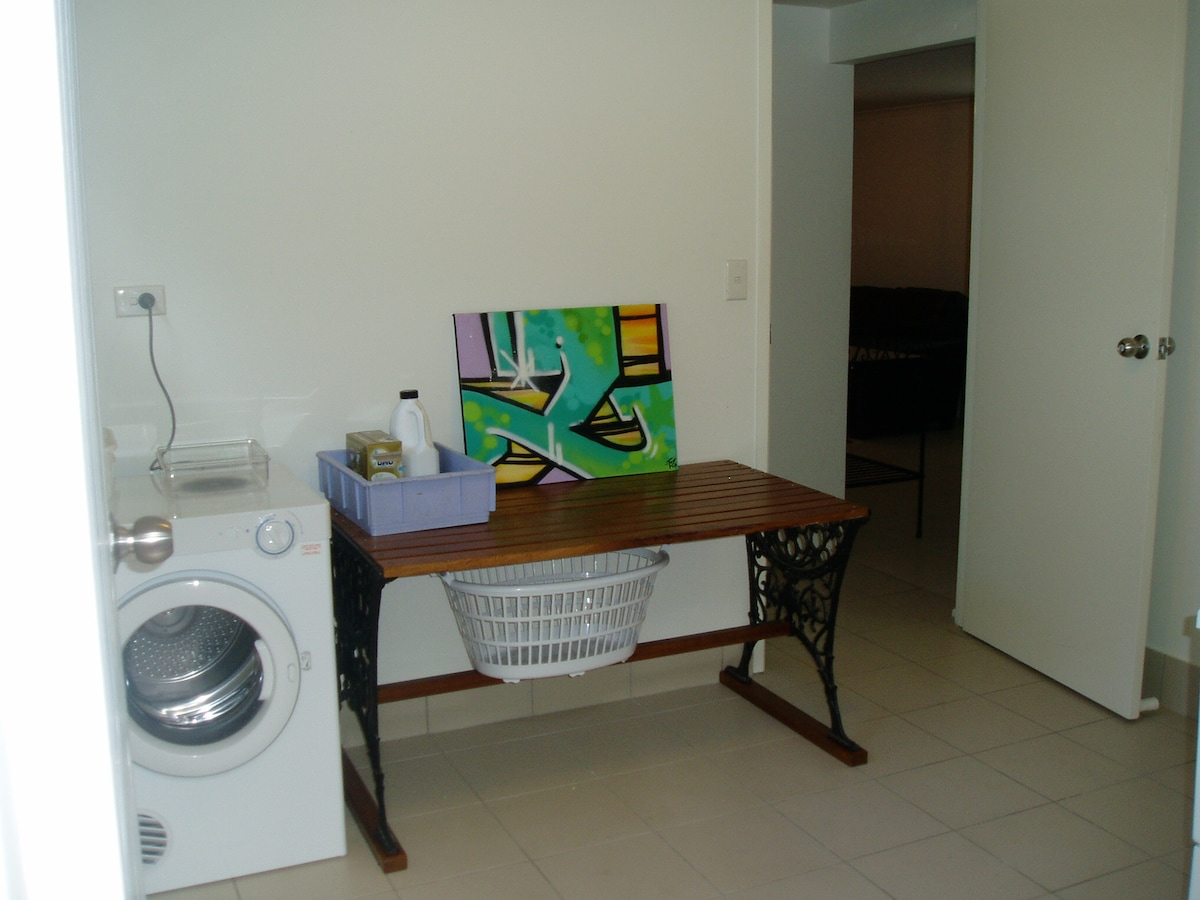 dryer and folding table in shared laundry (ironing board not shown)