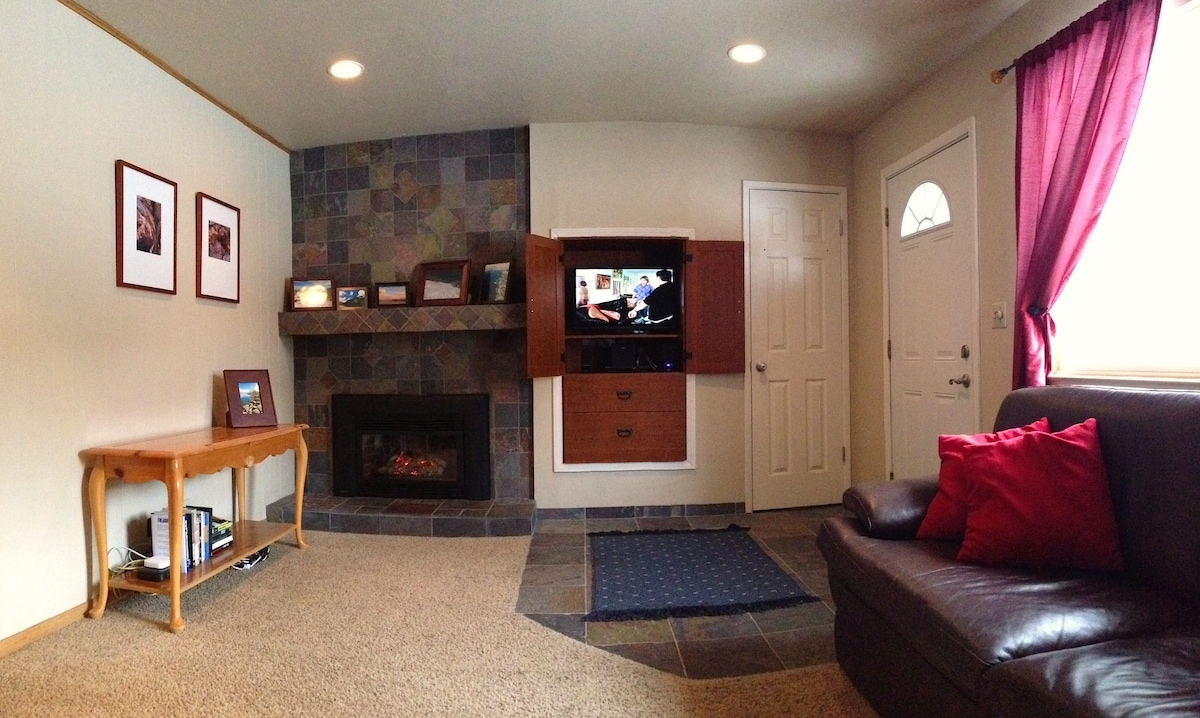 """Living room with fireplace and 28"""" TV, Chromecast, and DVD player"""