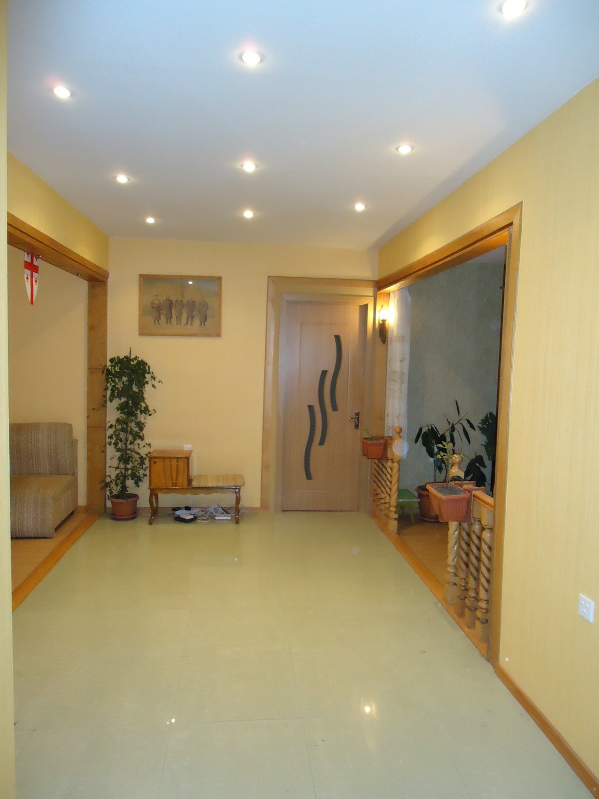 A large living room with kitchen area and bathroom.