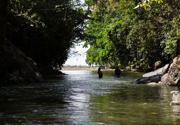 River at the surf break. 1 min walk from the cabinas