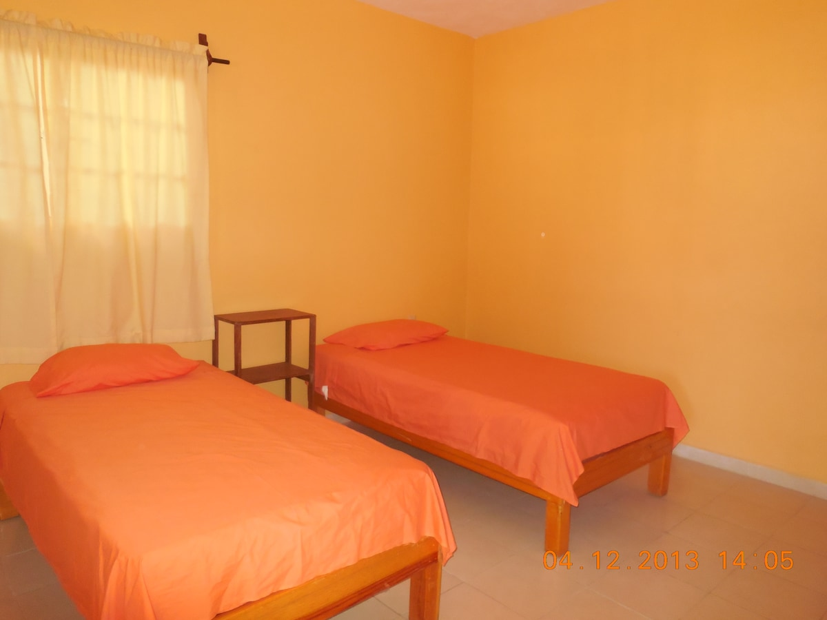 Second bedroom with two single beds which can be pushed together to create a double bed.