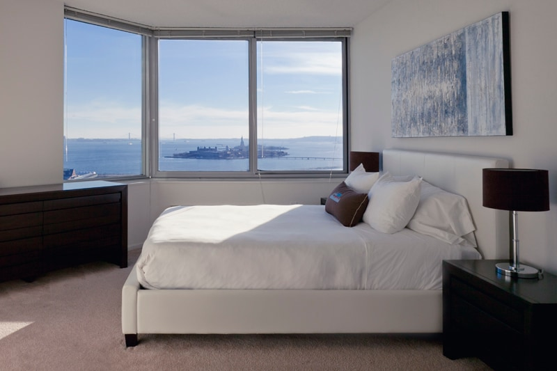 Master Bedroom with Queen Size Bed and Direct Statue of Liberty View