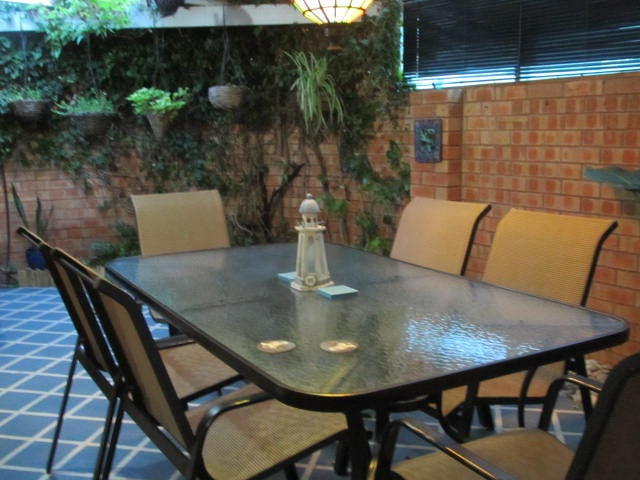 Private rear enclosed courtyard with BBQ