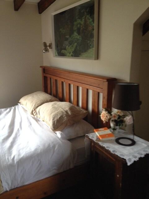 Sunny bedroom with view of Lake Wakatipu and Coronet Peak