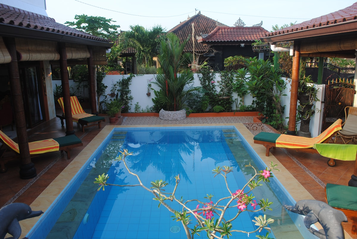 Pool separating the Main house and the Guesthouse