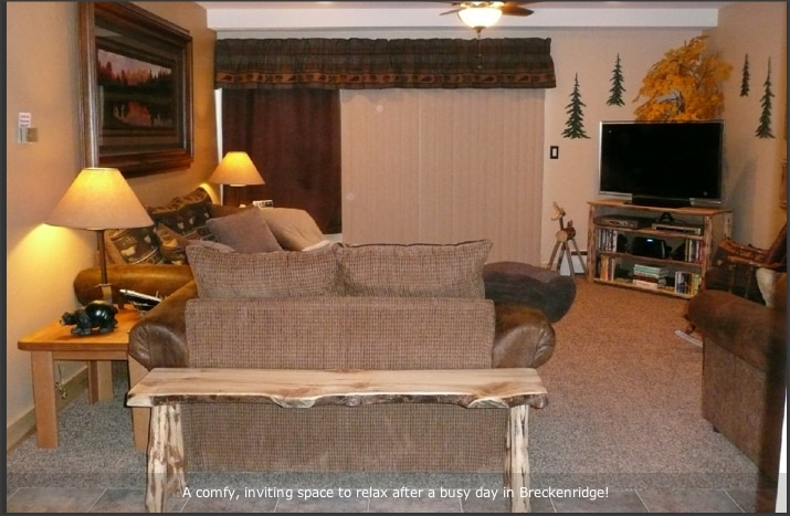 Large living area to hang out, flat screen TV, couch, loveseat and oversized chair.  Opens onto private patio space.