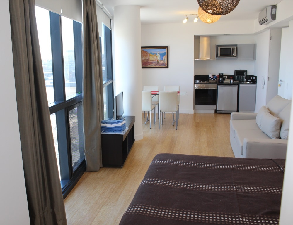 """Fully equipped studio at a brand new building in Puerto Madero. King size bed, double sofa-bed and complete kitchenette. Take advantage of discounted """"opening rates"""" !!"""