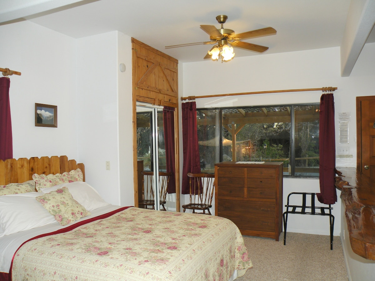 Large picture window provides lots of natural light, blackout curtains provided for late sleepers.
