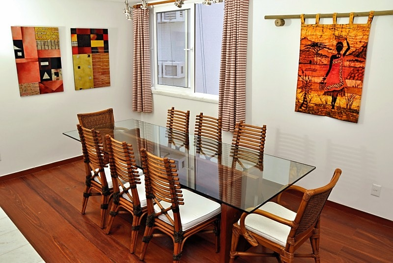 Dining area with hard-wood floor (maçaranduba), custom table with base of same wood, abstract art by Jesse Nguyen, batik from Swaziland
